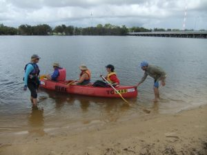 Canoeing on the Swan River with 3 people in the canoe