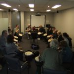 DBWA members sitting in a circle with drums at a Drumbeat lesson on 7th July 2012